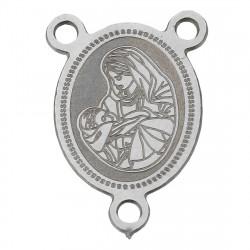 Konektor s náboženskými motivy z chirurgické oceli